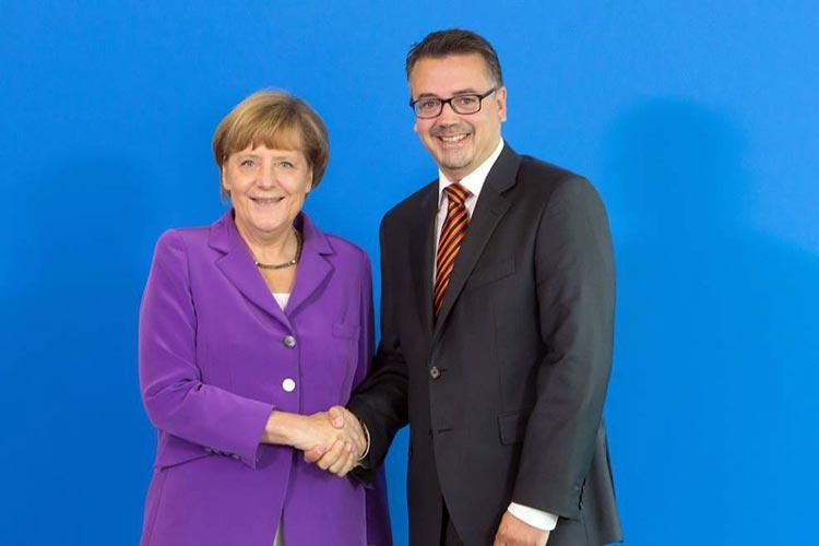 Bundeskanzlerin Angela Merkel wünschte Christoph Baak viel Glück für die OB-Wahl.