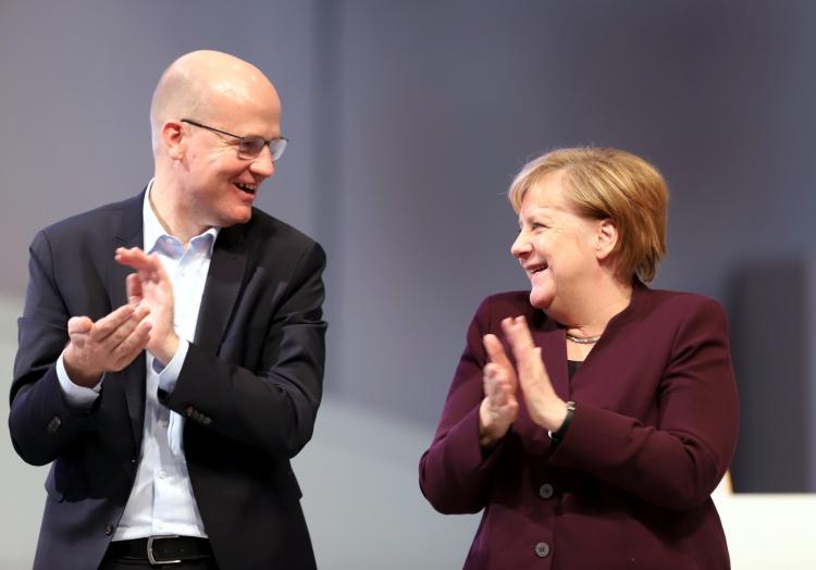 Ralph Brinkhaus und Angela Merkel, über dts Nachrichtenagentur