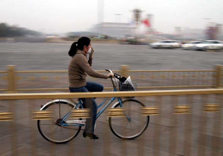 Fahrradfahrerin in Peking, über dts Nachrichtenagentur